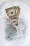 Gaspillage de l'argent Images libres de droits