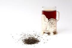 Gass av te i exponeringsglas-hållaren Royaltyfria Foton