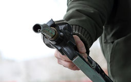 Gass pump nozzle. Hand holds gas pump nozzle Stock Image