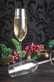 Gasses of champagne with Christmas tree. Two glasses of champagne with Christmas tree branch Stock Images
