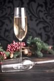 Gasses of champagne with Christmas tree. Two glasses of champagne with Christmas tree branch Stock Photos
