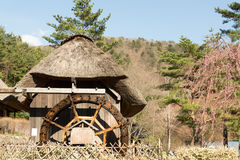 Gassho House with Water Mill at Iyashi-no-Sato Village Royalty Free Stock Photos