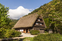 Gassho Zukuri home, Shirakawa Go, Japan. Outside of traditional farm house, gassho zukuri, in Shirakawa Go, Japan on sunny day with blue skies Royalty Free Stock Photo