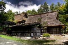 Gassho-zukuri stil inhyser på Hida inget Sato museum, Takayama, Japan Royaltyfria Bilder
