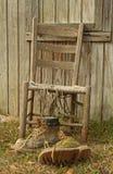 gastado trabalhe carregadores e cadeira Fotografia de Stock