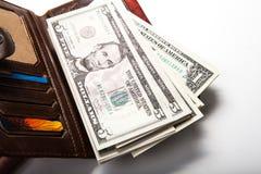 Gastar dinero en su cartera Fotos de archivo libres de regalías