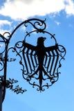 Gasthausboom, der einen Adler zeigt Lizenzfreie Stockbilder