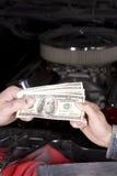 Gasto del coche del dinero Imagenes de archivo