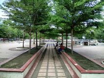 Gaston park,  Cagayan-de-oro, Philippines. A park with two pairs of couple hanging out Stock Photo
