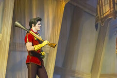 Gaston Walks with a Gun. GREEN BAY, WI - FEBRUARY 10: Gaston walks wiht a gun from Beauty and the Beast at the Disney Princesses show at the Resch Center on Stock Image