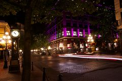 Gastown at night, Vancouver, British Columbia, Canada. The famous steam clock and other buildings in Vancouver, Canada's Gastown neighbourhood are shown at night Royalty Free Stock Images