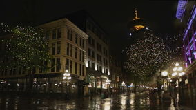 Gastown Rainy Night Vancouver. Reflections on the wet street during a rainy night in Vancouver's touristy Gastown district. British Columbia, Canada stock footage