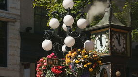 Gastown Tourist Steam Clock, Vancouver. The Gastown steam clock is in the heart of Vancouver's best known tourist area. Gastown is in downtown Vancouver and is stock video