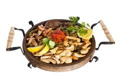 Gastronomisch voedsel op kleiplaat Stock Fotografie