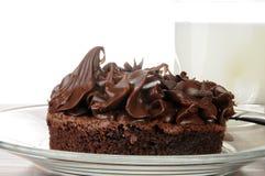 Gastronomische chocoladebrownie met melk stock afbeelding