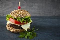 Gastronomische hamburger Stock Afbeeldingen