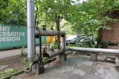 Gasversorgungsrohrleitung im redtory kreativen Garten, Guangzhou, Porzellan Lizenzfreies Stockfoto