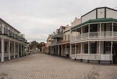 Gata med koloniinvånarehus i Tauranga Arkivfoto