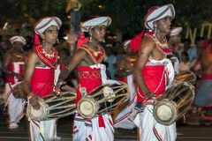 Gatabera Players perfom infront of huge crowds lining the streets of Kandy during the Esala Perahera in Kandy, Sri Lanka. Royalty Free Stock Photo