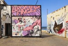 Gatakonst (grafitti) vid brutna Fingaz avivisrael telefon Royaltyfri Foto