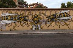 Gatakonstväggmålningar i rome royaltyfri fotografi