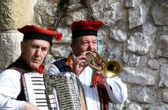 Gatamusiker i Krakow, Polen Royaltyfri Foto