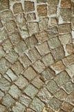 Gatatrottoarbakgrund, vaggar textur Arkivfoto
