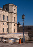 Gatchina Palace. Russia. The left wing of the palace in the foreground. Water ditch and a bridge through it. Stock Image