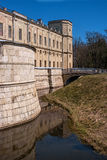 Gatchina Palace. Russia. The right wing of the palace. Water ditch and a bridge through it. Royalty Free Stock Photography