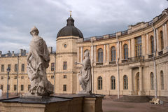 Gatchina Palace. Sculptures at the main entrance and a lookout tower. Royalty Free Stock Photo