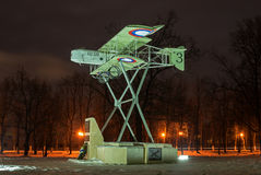Gatchina, Russia - February 10, 2016: Monument in honor of the 100th anniversary of the first military airport in Russia. Airplane Model Foreman. Night Stock Images