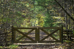 Gate. A wooden gate on the path Stock Image