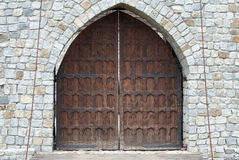 Gate. Old brown wooden gate in stone wall Royalty Free Stock Photography