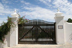 Gate. Beautiful gate to the house royalty free stock photo