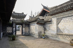 Gate of ancient Chinese dwelling house on sunny day Royalty Free Stock Photography