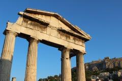 The Gate of Athena Archegetis Roman Agora of Athens, with backround the Acropolis of Athens, Greece royalty free stock photography