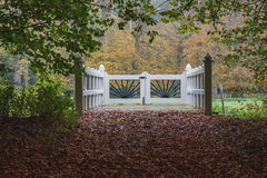 Gate in the autumn. Autumn in the old manor park, gives a surprisingly beautiful autumn scenery Stock Photo