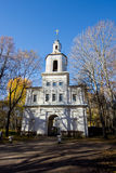 Gate belltower, entrance to the estate of Bobrinsky Counts at autumn trees stock photography
