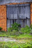 Gate of big barn. Close-up of the gate of big brick barn in countryside Stock Photography