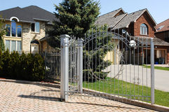 Gate on big homes. Stock Photos
