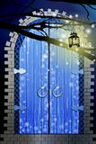 Gate. blue color. a lantern. On a tree branch lights up Royalty Free Stock Photo