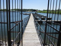 Wrought Iron Gate Leading To Wooden Fishing / Boat Royalty Free Stock Images