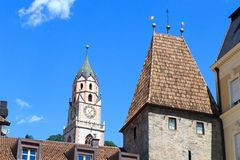 Gate Bozener Tor and church tower in Merano, South Tyrol stock image