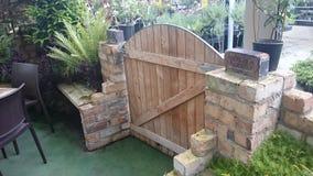 Gate. Brick wall garden stock images