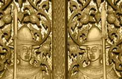 Gate of Buddhism temple with  golden soldier sculpture  decorati Royalty Free Stock Image