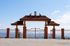 Gate in Buddhist monastery highly in mountains Royalty Free Stock Photography