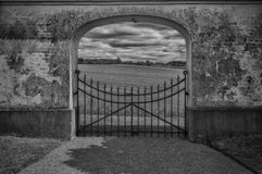 The gate bw. A gate in the countryside i skane sweden Stock Photos