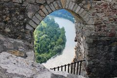 River near the Castle in Slovakia. Gate in the Castle in Slovakia. There are stairs in the gate. On the down is a River Stock Photos