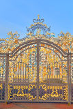 Gate of Catherine palace fence in Tsarskoye Selo. Gate of Catherine palace fence in Tsarskoye Selo with golden double-headed eagle, suburb of St.Petersburg Royalty Free Stock Images