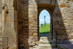 Gate of a chapel ruin and street lamp. Gate of a chapel ruin, a street lamp overlooking Stock Image